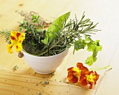 Assorted kitchen herbs and nasturtium flowers