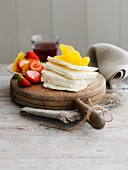 Slices of haloumi cheese with oranges and strawberries