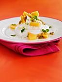 Meringue with papaya and passion fruit sauce