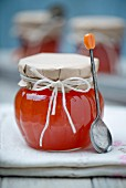 Papaya marmalade in a twist top glass jar