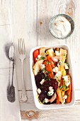 Oven-roasted vegetables with feta and olive oil (view from above)