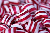 Lots of red and white striped peppermint candies
