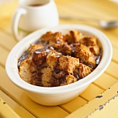 Bread and butter pudding with chocolate sauce