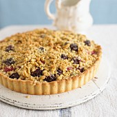 A whole boysenberry-apple tart with streusel topping