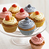Cupcakes with raspberries and blueberries on a cake stand