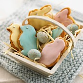 Assorted Easter cookies in a wooden basket
