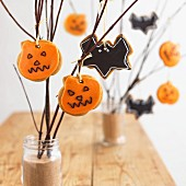 A variety of Halloween cookies hanging on branches