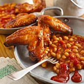 Chicken wings with baked beans for Halloween