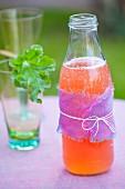 Homemade rhubarb lemonade on a garden table