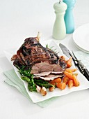 Roast leg of lamb, partly sliced, with vegetables