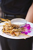 A Platter of Shrimp Skewers with a Yogurt Dip