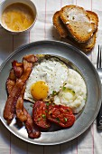 Breakfast; Eggs, Bacon, Grits, Stewed Tomatoes and a Side of Toast with Coffee