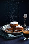 Squash doughnuts with icing sugar, served with a cup of coffee