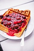 Waffle with cherry sauce