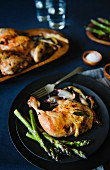Herb chicken with green asparagus