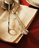 Antique cake serving knives on linen napkins, Close Up