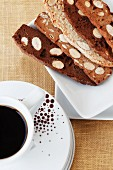 A cup of coffee and sweet almond toast slices
