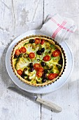 Vegetable tart with broccoli, tomatoes and olives