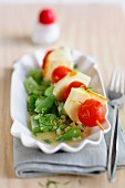 Braised cucumbers with a cheese and tomato skewer