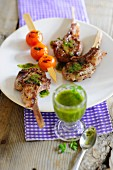 Grilled lamb chops with a tomato skewer and pesto