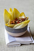 Endive salad with quinoa, parmesan and nuts