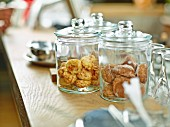 Almond biscuits in jars on the counter in a restaurant
