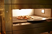 Pizza in a baking oven