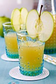 Glasses of apple juice decorated with slice of apple