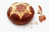 A pretzel roll and crumbs