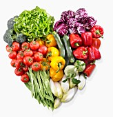 A heart made of vegetables and lettuce
