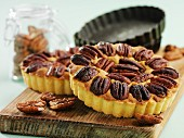 Small pecan nut tartlets on a chopping board