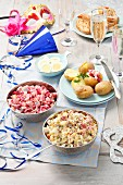 Party buffet with herring salad and accompaniments