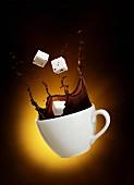 A splash of coffee with sugar cubes