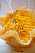 Saffron risotto in a parmesan basket