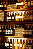 Assorted bottles of wine on shelves in a restaurant