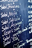 Menu with a list of salads in a restaurant