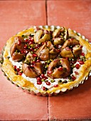 Fig and mascarpone tart with pomegranate seeds and pistachios
