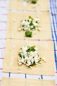 Home-made wontons with feta and mint filling