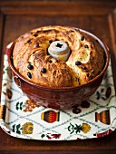 Bundt cake with raisins in a baking mould