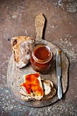 Haw berry jam and bread on a chopping board
