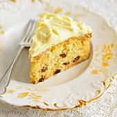 A slice of lemon cake with raisins