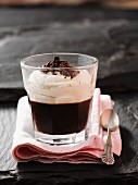 Coffee dessert with cream and grated chocolate