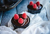 Chocolate Frosted Cupcakes with Raspberries