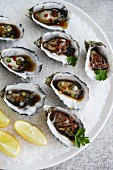 Grilled oysters with assorted dressings
