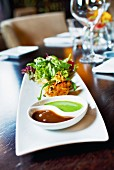 tandoori prawn with salad and two sauces