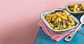 Pasta bake with penne, haddock and spinach