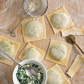 Making ravioli with spinach and ricotta filling