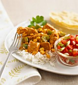 Chicken curry with sweetcorn and peppers on a bed of rice