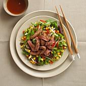 Teriyaki beef salad with sweetcorn and sugar snap peas