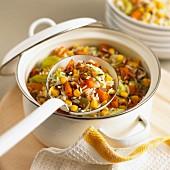 Rice stew with squash, sweetcorn and leek